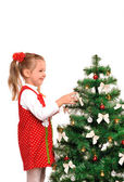 Little girl and christmas tree — Стоковое фото