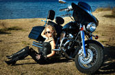 Stylized photo of young beautiful woman and bike — Photo