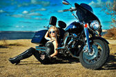 Stylized photo of young beautiful woman and bike — Foto de Stock