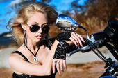 Stylized photo of young beautiful woman and bike — Stockfoto