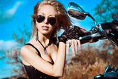 Stylized photo of young beautiful woman and bike — 图库照片