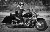 Stylized photo of young beautiful woman and bike — Foto Stock