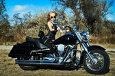 Stylized photo of young beautiful woman and bike — Stock Photo
