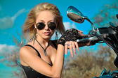 Stylized photo of young beautiful woman and bike — Стоковое фото