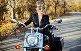 Young beautiful woman on a bike — Стоковое фото