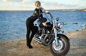 Stylized photo of woman and bike — Stock Photo
