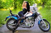 Young beautiful woman and bike — Stock Photo