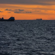 Two merchant ships underway at sunset — Stock Photo