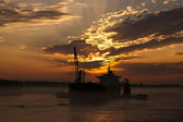 Ship at anchor durint sunset — Stock Photo