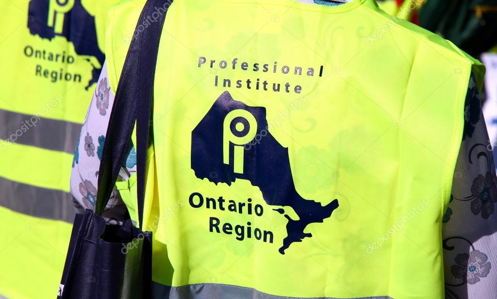 A vest of the Professional Institure at the 2012 Labor Day Parade in Toronto — Stock Photo #12777392
