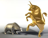 Golden bull and metal bear — Stock Photo