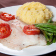 Healthy fried tilapia fish with asparagus — Stock Photo
