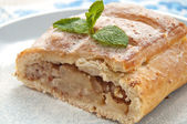 Slice of an apple strudel on the plate — Stock Photo