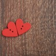Two wooden red hearts on the wooden board — Stock Photo