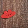 Two wooden red hearts on the wooden board — Stock Photo #18559807