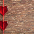 Two red hearts on wooden board — Stock Photo