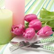 Setting the table on holiday with flowers and candles - Stock Photo