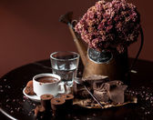 Piece of chocolate bar with hot chocolate drink — Stock Photo