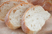 Sliced ciabatta bread on the board — Stock Photo