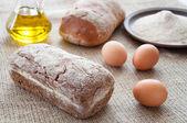 Homemade bread ciabatta on the table. Olive oil, eggs and flour — Stock Photo
