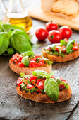 Italian tomato bruschetta with chopped vegetables — Stock Photo