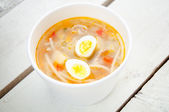 Chicken soup with noodles and boiled eggs — Stock Photo