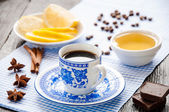 Espresso in blue cup with lemon and honey on table — Stock Photo