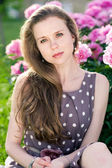 Nice young woman in the park near peonis — Foto de Stock