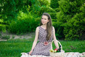 Beautiful woman  with basket  on the grass — Foto de Stock