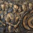 Vietnam Hanoi - March 2012: Detail of mural depicting defeated — Stock Photo