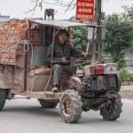 Vietnam Yen Khanh Village - March 13, 2012: Ancient tractor. — Stock Photo #17654435