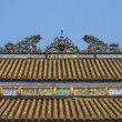 Vietnam Hué Citadel: Roof decoration on Hall of Supreme Harmony — Stock Photo #17652979