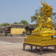 Vietnam Hué Citadel: Golden lion dragon snake on courtyard — стоковое фото #17653063