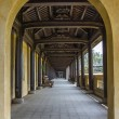 Vietnam Hué Citadel: long view into covered hallway with open side. — Stock Photo