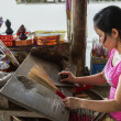 Stockfoto: Vietnam Hué: Manually making incense stick on twig by rolling.