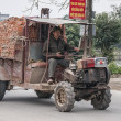 Stock Photo: Vietnam Yen Khanh Village - March 13, 2012: Ancient tractor.