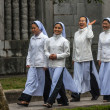 Stock Photo: Vietnam Phat Diem Cathedral - March 13, 2012: Four young Vietnamese nuns.