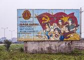 Vietnam Nam Dinh City: Communist propaganda sign along the road. — Stockfoto