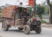 Vietnam Yen Khanh Village - March 13, 2012: Ancient tractor. — Stock Photo