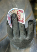 Vietnam Chua Bai Dinh Pagoda: Close up of Buddhist Philosopher with money in hand. — Stock Photo