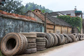 Vietnam: Line of retired truck tires along village road. — 图库照片