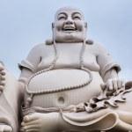 Massive white sitting Buddha statue isolated from decor. — Stock Photo