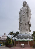 Combination shot of Amitabha statue with Buddha in background. — Stock Photo