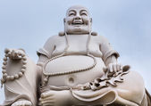 Massive white sitting Buddha statue isolated from decor. — Stock Photo