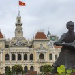 Ho Chi Minh statue and Saigon City Hall with flag. — Stock Photo #29617551
