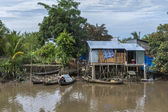 Small boats dock at a shack on stilts in the jungle. — Stock Photo