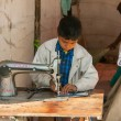 Nagaur in RajasthIndi- February 2011 - Child labor: boy sewing in booth on market. — Stock Photo #30456885