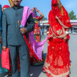 Stock Photo: Deshnoke in RajasthIndi- February 2011 - Hindu Groom brings his veiled trophy wife - bride - home on leash.