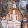 Stock Photo: Sitting Jain figures carved out of Gwalior's Rock in India.