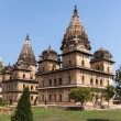 Group of three square Bundela Cenotaphs in park of India's Orchha. — Stock Photo